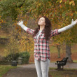Teenage Girl Standing In Autumn Park With Arms Outstretched — Stock fotografie