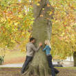 Romantic Teenage Couple By Tree In Autumn Park — Stockfoto