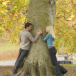 Romantic Teenage Couple By Tree In Autumn Park — Stockfoto #4837059