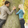 Romantic Teenage Couple By Tree In Autumn Park — Stok fotoğraf