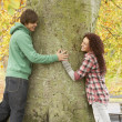 Romantic Teenage Couple By Tree In Autumn Park — Stock Photo