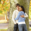 Romantic Teenage Couple By Tree In Autumn Park — 图库照片