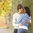 Romantic Teenage Couple By Tree In Autumn Park — Stockfoto #4837086