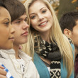 Close Up Of Group Of Four Teenage Friends In Autumn Woodland — Stock Photo