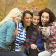 Group Of Four Teenage Girls Taking Picture With Camera Sitting O — Stock Photo #4837102