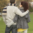 Back View Of Romantic Teenage Couple In Autumn Landscape - Stock Photo