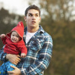 Shocked Teenage Boy Holding Baby — Stock Photo