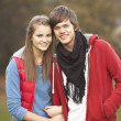 Romantic Teenage Couple Walking Through Autumn Landscape — Stockfoto