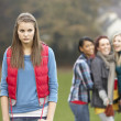 Upset Teenage Girl With Friends Gossiping In Background — Stock fotografie