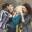 Stock Photo: Group Of Female Teenagers Bullying Girl