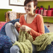 Young Woman Sitting In Chair Knitting — Stock Photo