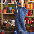 Naked Woman Standing In Knitted Item Standing In Front Of Yarn D — Stock Photo