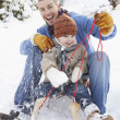 Father And Son Sitting On Sledge - Stockfoto