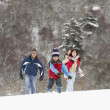 Family Having Fun In Snowy Countryside — Stock Photo #4837265