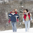Stock Photo: Family Having Fun In Snowy Countryside
