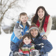 Family Having Fun In Snowy Countryside — Stock Photo