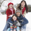 Family Having Fun In Snowy Countryside — Stockfoto