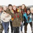 Group Of Teenage Friends Having Fun In Snowy Landscape — Stock Photo