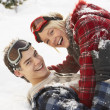 Romantic Teenage Couple Having Fun In Snow - Stok fotoraf