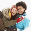 Foto Stock: Romantic Teenage Couple Having Fun In Snow