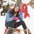 Teenage Girl With Sledge Next To Snowman - 图库照片