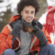 Man Wearing Winter Clothes In Snowy Landscape - Stock Photo
