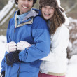Romantic Teenage Couple In Snow - Foto Stock