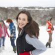 Group Of Young Friends Having Fun In Snowy Landscape - Stock Photo