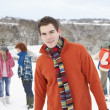 Stockfoto: Group Of Young Friends Having Fun In Snowy Landscape