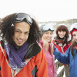 Group Of Teenage Friends Having Fun In Snowy Landscape Wearing S — Foto de Stock