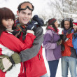 Group Of Teenage Friends Having Fun In Snowy Landscape Wearing S - 图库照片