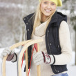 Teenage Girl Holding Sledge In Snowy Landscape — Stock Photo