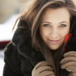 Close Up Of Teenage Girl Wearing Fur Coat In Snowy Landscape — Foto de Stock
