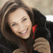 Close Up Of Teenage Girl Wearing Fur Coat In Snowy Landscape - Stock Photo