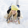 Teenage Girl Riding On Sledge In Snowy Landscape - Stock fotografie