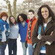 Group Of Teenage Friends Having Fun In Snowy Landscape Wearing S - Stock Photo