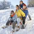 Family Enjoying Sledging Down Snowy Hill — Stock Photo