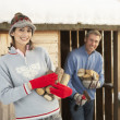 Young Couple Collecting Logs From Wooden Store In Snow — Stock Photo #4837558