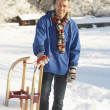 Middle Aged Man Standing In Snowy Landscape Holding Sledge — Stock Photo