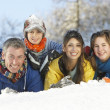 Young Family Having Fun In Snowy Landscape — Stock Photo