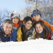 Stock Photo: Young Family Having Fun In Snowy Landscape