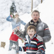 Young Family Having Snowball Fight In Snowy Landscape — Stock Photo