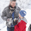 Father And Son Stopping For Hot Drink And Snack On Walk Through — Stockfoto