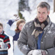 Father And Children Having Snowball Fight In Winter Landscape - Stockfoto