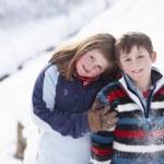 Portrait Of Two Children In Snowy Landscape — Stock Photo