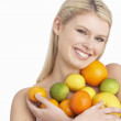 Young Woman Holding Citrus Fruit In Studio — Stock Photo