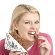 Guilty Looking Young Woman Eating Big Bar Of Chocolate In Studio — Stock Photo