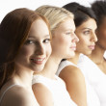 Portrait Of Four Attractive Young Women In Studio Standing In Li — Stock Photo #4837657