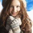 Teenage Girl Wearing Warm Winter Clothes And Hat In Studio - Foto de Stock  