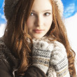 Teenage Girl Wearing Warm Winter Clothes And Hat In Studio — Stock Photo